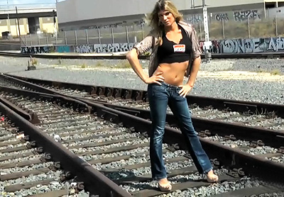 Train tracks bts Angelina strips on the train tracks. Angelina Torres.